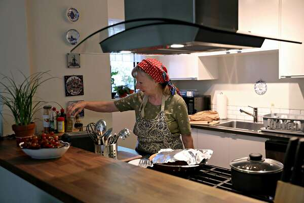 Astrid Granger cooks breakfast in the Santa Rosa town house she and her husband rented after the Tubbs Fire destroyed their home.