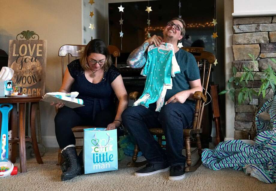 Melissa Geissinger and husband, Cole, open gifts during their baby shower in Sebastopol in November. Photo: Guy Wathen / The Chronicle 2017