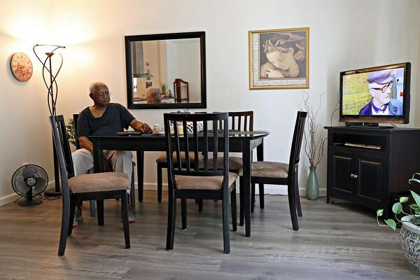 Henry Granger watches television after breakfast with his wife, Astrid, on Saturday, July 7, 2018, in the Santa Rosa townhouse they rented after the Tubbs Fire destroyed their home.
