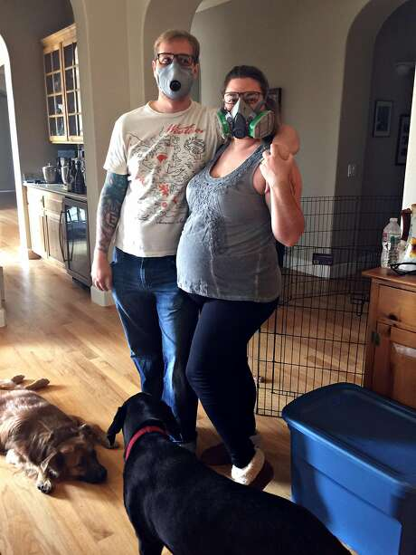 A few days after the Tubbs Fire, Cole and Melissa Geissinger wear gas masks to protect themselves from the smoke as the wildfires continue to burn. They evacuated to Melissa's parents' home in Sebastopol. Photo: Courtesy Geissinger Family 2017