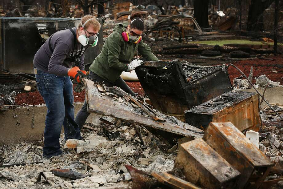 Cole Geissinger (left) and friend Valerie Soldate search through the rubble of Cole's home in the Coffey Park neighborhood of Santa Rosa for anything he can salvage. In late October, residents were finally let back in to sift through what was left after the Tubbs Fire. Photo: Santiago Mejia / The Chronicle 2017