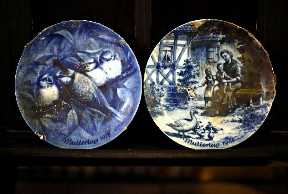 Decorative plates that survived the fire are displayed in the basement flat in Oakland where Henry and Astrid Granger stayed after the lost their home.  Photo: Guy Wathen / The Chronicle