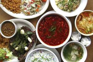 An array of Mexican, Eastern European and American dishes from Oky Doky Restaurant and Bar, located in the old Cha-Cha's building. Clockwise from top left: puffy tacos, Russian salad, chicken tortilla soup, pelmeni dumplings in broth, a buttermilk and sour cream soup called okroshka, steak with nopales and a bowl of borscht (center).
