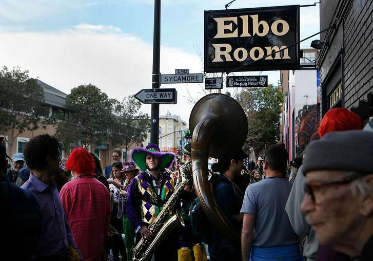 Monk Funkster stands outside the Elbo Room with fellow musicians preparing to start the fifth annual Fat Tuesday parade through the Mission district in San Francisco, Calif., on Tuesday Feb. 9, 2016