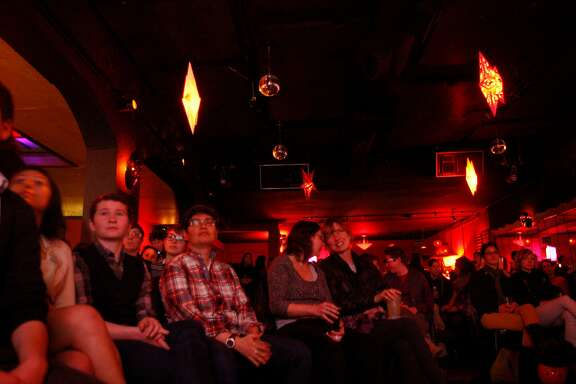 A crowd listens to readers during Sister Spit, a queer spoken word festival, at Elbo Room in San Francisco, Calif., on Monday, March 21, 2011.