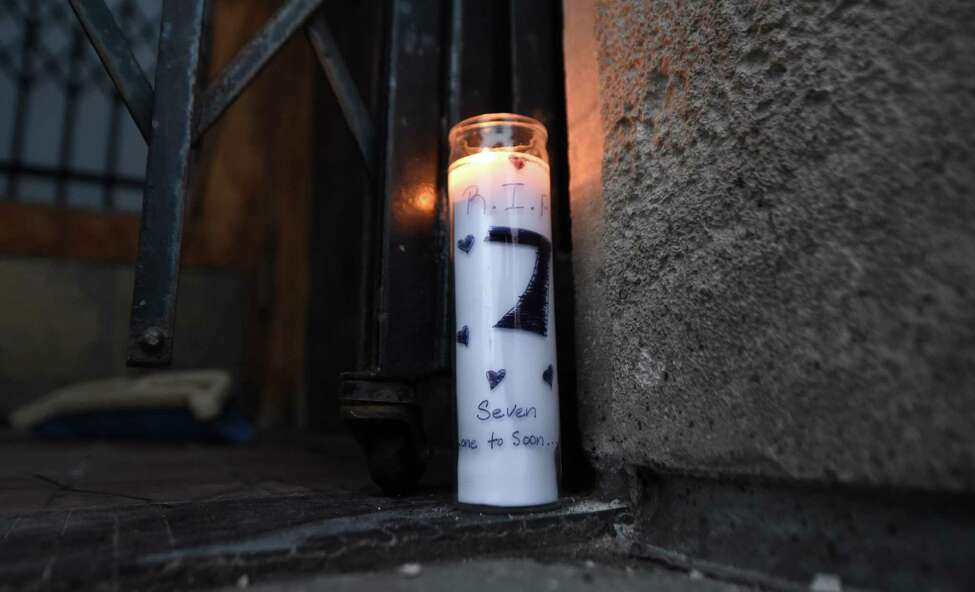A solitary candle burns in the doorway of Club Phoenix on Central Ave. for Joseph Davis, who succumbed to his wounds on Monday, Oct. 1, 2018, in Albany, N.Y. Davis was shot several times in the torso early Saturday outside the nightclub. (Will Waldron/Times Union)
