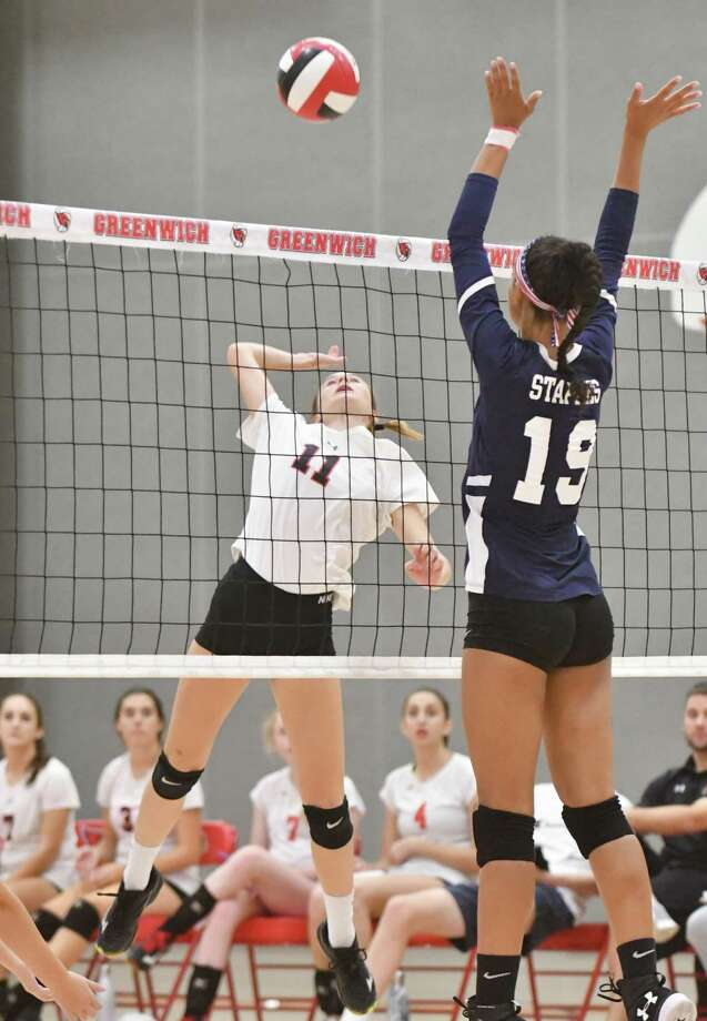 Adele Sotgiu (11) of the Greenwich Cardinals attempts a kill shot during a game against the Staples Wreckers on Monday October 1, 2018, at Greenwich High School in Greenwich, Connecticut. Photo: Gregory Vasil / For Hearst Connecticut Media / Connecticut Post Freelance