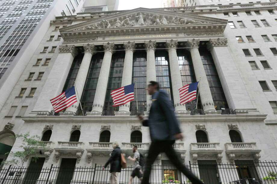 FILE - In this June 24, 2016, file photo, people walk by the New York Stock Exchange. On Monday, Oct. 1, 2018, stocks are opening broadly higher on Wall Street, led by big gains in industrials after General Electric named a new CEO. (AP Photo/Richard Drew, File) Photo: Richard Drew / Copyright 2018 The Associated Press. All rights reserved.