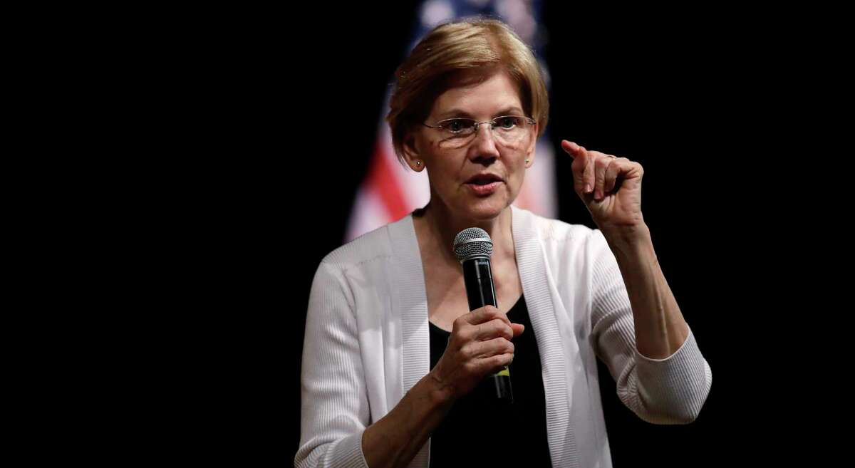 FILE - In this Wednesday, Aug. 8, 2018 file photo, U.S. Sen. Elizabeth Warren, D-Mass., speaks during a town hall style gathering in Woburn, Mass. On Saturday, Sept. 29, 2018, the Boston Globe reported that Warren said she'll take a