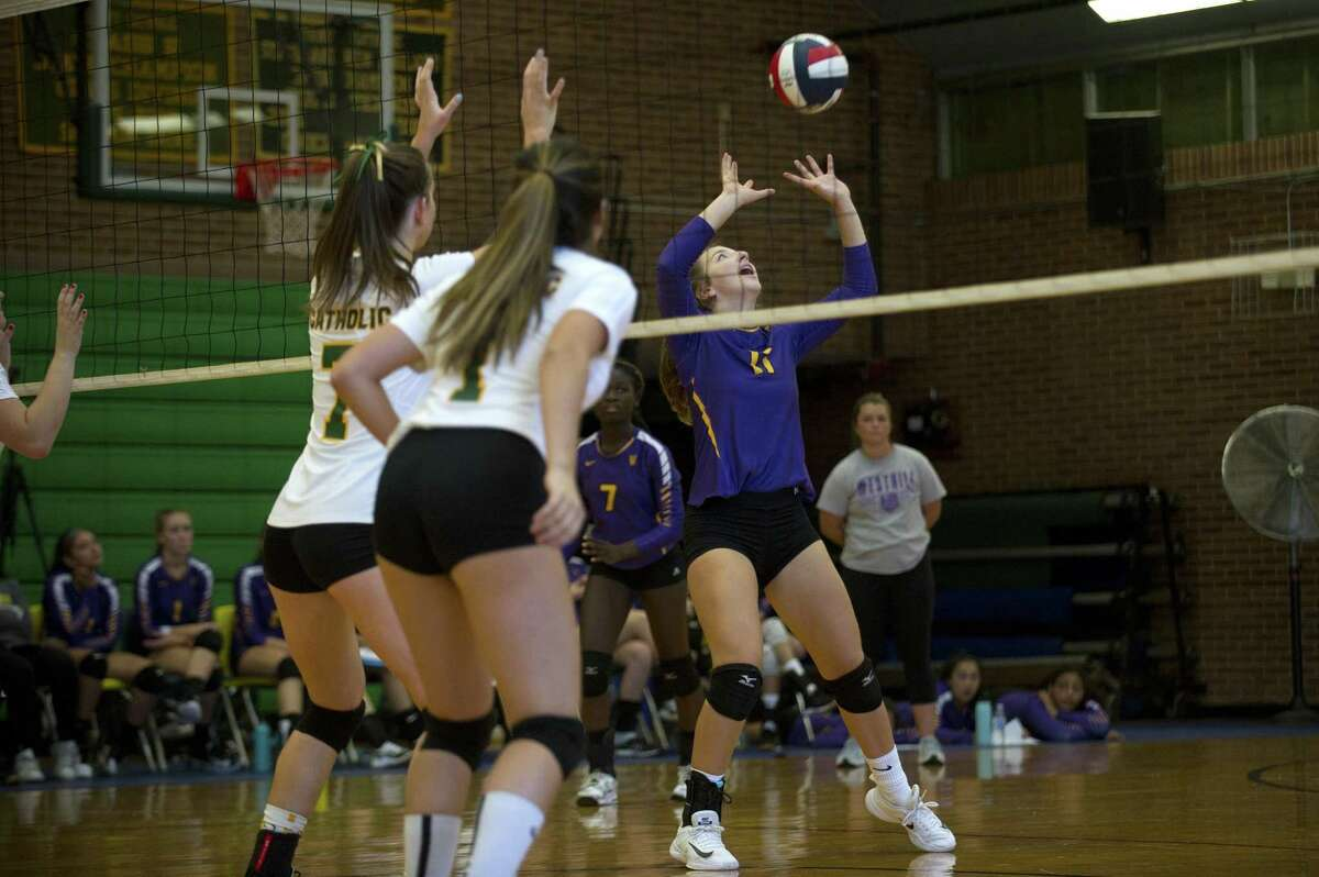 Westhill High School junior Sophia Thagouras sets the ball for a teammate during a varsity girls volleyball game against Trinity Catholic High School inside Trinity Catholic's Walsh Court in Stamford, Conn. on Monday, Oct. 1, 2018.