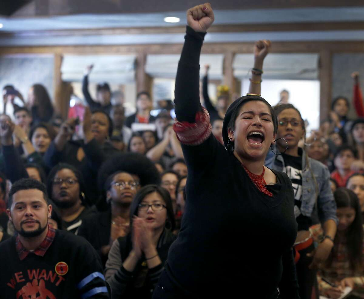 Yesenia Mendez and other students from the College of Ethnic Studies rise up during a contentious meeting with San Francisco State University President Les Wong and other administrators in San Francisco, Calif. on Thursday, Feb. 25, 2016.