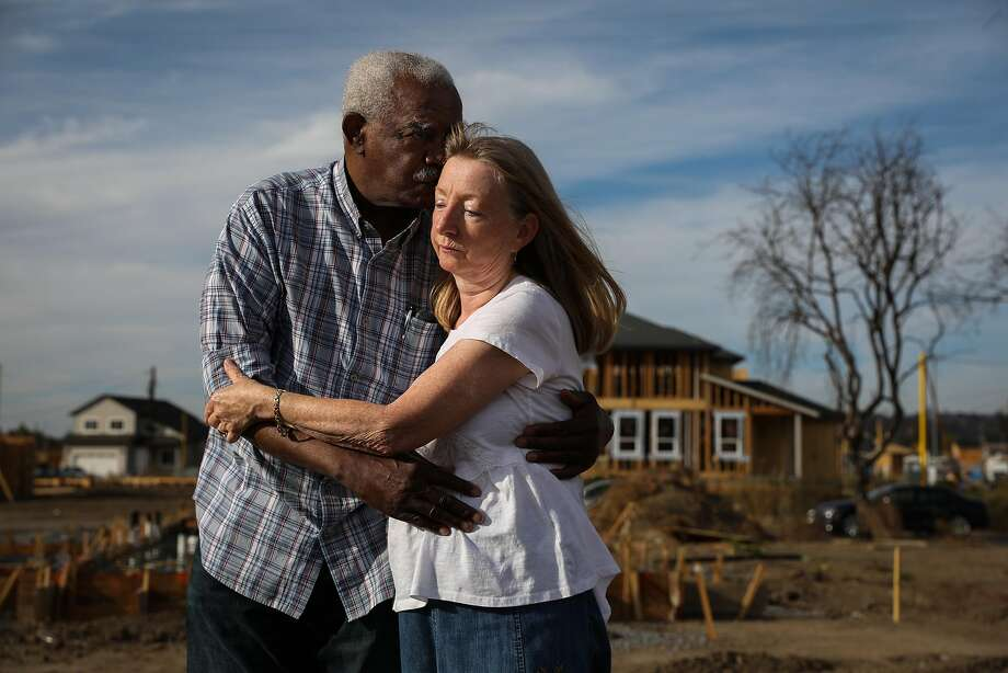 Husband and wife Henry Granger and Astrid Granger embrace as they stand for a portrait on the destroyed property that was their home before the Tubbs Fire tore through it last year in Santa Rosa, California, on Thursday, Sept. 27, 2018. Photo: Gabrielle Lurie / The Chronicle