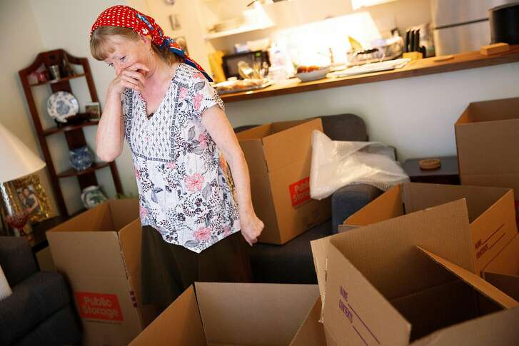 Astrid Granger packs her belongings from her temporary home on Friday, June 29, 2018, in Santa Rosa, Calif. Granger and her husband Henry have been living in a town home in Santa Rosa since their Coffey Park home was destroyed in the Tubbs Fire. Granger was packing her belongings from the temporary place to move to Windsor.