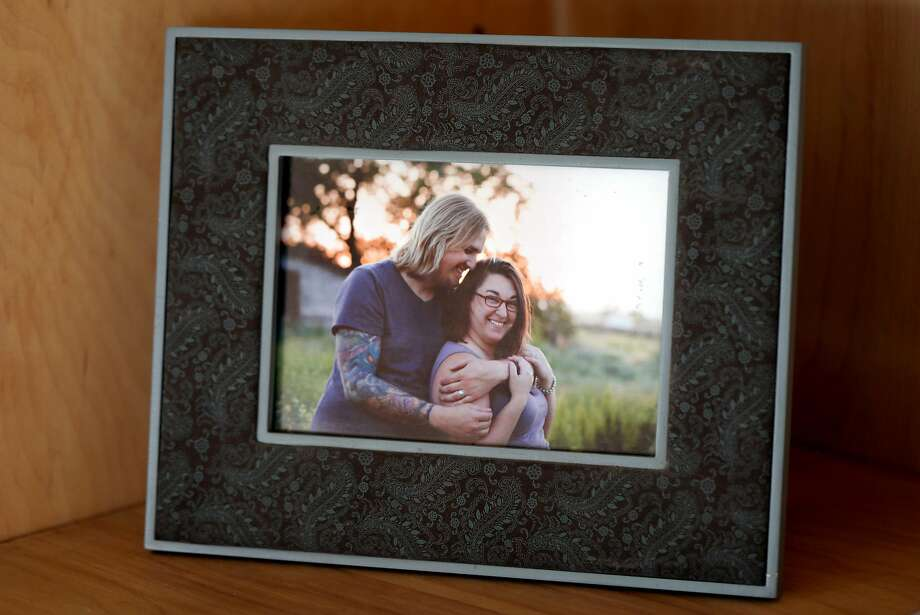 A framed portrait of Cole and Melissa Geissinger sits on a shelf in the living room of their Bodega Bay rental home on Sunday, August 19, 2018. Photo: Guy Wathen / The Chronicle