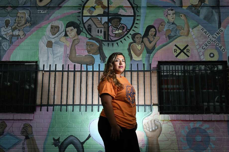 Ingris Moran, lead organizer for Tenants and Workers United, poses in front of a mural outside the advocacy group's office in Alexandria, Va. Photo: Washington Post Photo By Matt McClain / The Washington Post