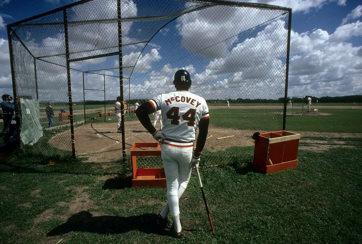 PHOENIX, AZ - CIRCA 1970's: First baseman Willie McCovey #44 of the San Francisco Giants standing at the batting cage waiting his turn to hit circa mid 1970's in spring training in Phoenix, Arizona. McCovey played for the Giants from 1959-80. (Photo by Focus on Sport/Getty Images)