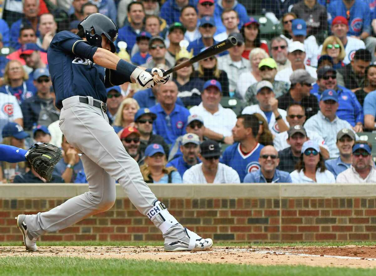 Milwaukee Brewers' Christian Yelich (22) hits an RBI single during the third inning of a tiebreak baseball game against the Chicago Cubs on Monday, Oct. 1, 2018, in Chicago. (AP Photo/Matt Marton)