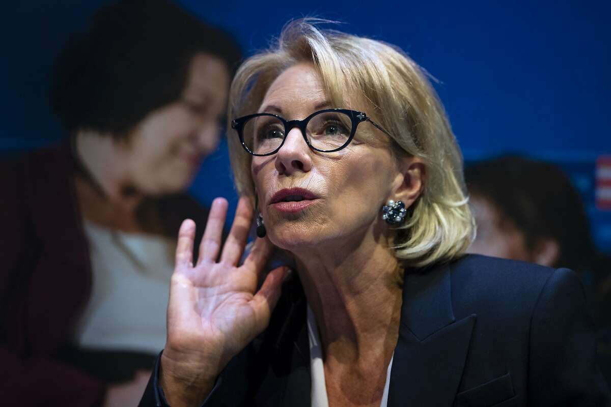 Education Secretary Betsy DeVos listens to a question during a student town hall at National Constitution Center in Philadelphia, Monday, Sept. 17, 2018. (AP Photo/Matt Rourke)