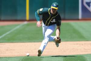OAKLAND, CA - AUGUST 05: A ball is hit softly towards Oakland Athletics third baseman Matt Chapman (26) during the regular season baseball game between the Oakland Athletics and the Detroit Tigers on August 5,2018 at Oakland-Alameda County Coliseum in Oakland,CA (Photo by Samuel Stringer/Icon Sportswire via Getty Images)