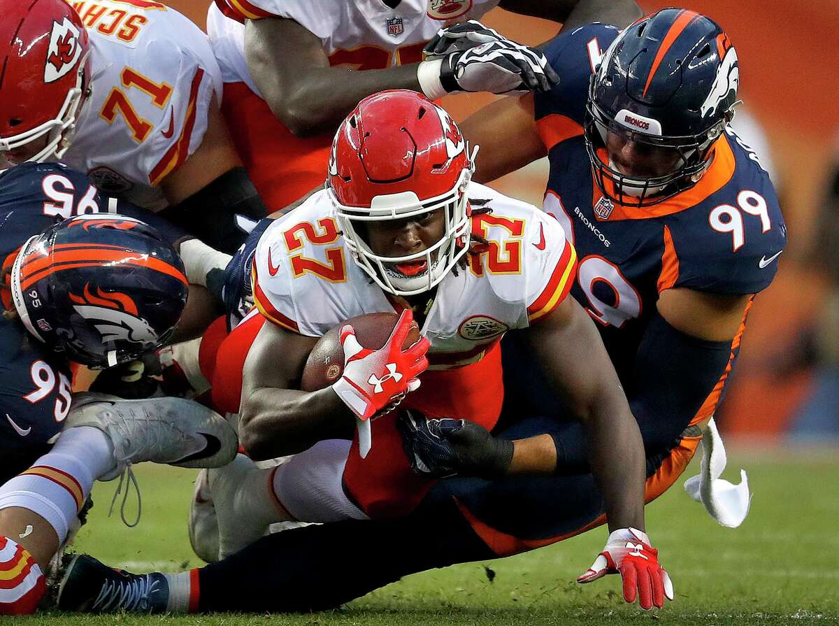 Kansas City Chiefs running back Kareem Hunt (27) is tackled by Denver Broncos defensive end Adam Gotsis (99) during the first half of an NFL football game, Monday, Oct. 1, 2018, in Denver. (AP Photo/David Zalubowski)
