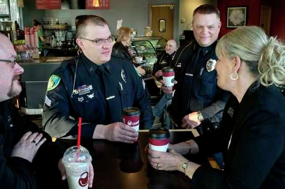 Local police officers meet with the public during a previous Coffee with a Cop Day. (Daily News File Photo)
