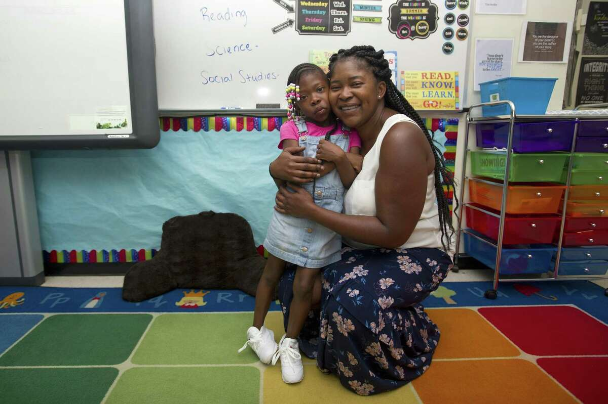 Northeast Elementary School fourth grade teacher April McLeod poses for a photo with her daughter MaeLani, 5, who is starting kindergarten in Stamford, Conn. on Thursday, Aug. 30, 2018. The pair will be in the same building for school for the first time.