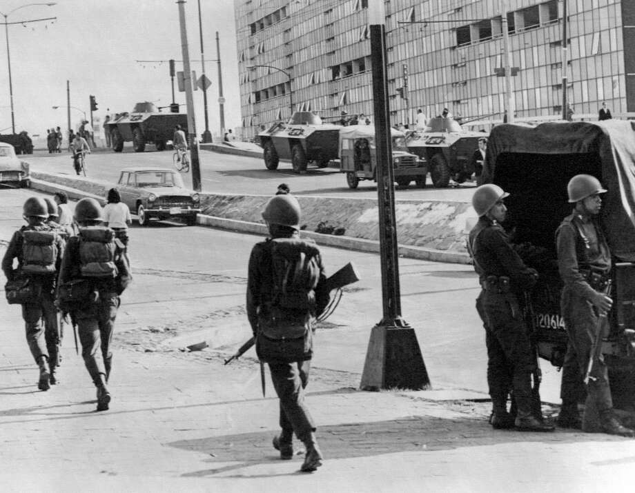 Armored vehicules and soldiers patrol in the streets of the Tlatelolco section of Mexico City, 05 October 1968, three days after Mexican army opened fire on youth demonstrators during protest against police actions, causing between 200 and 300 deaths. The Tlatelolco Massacre, also known as The Night of Tlatelolco, took place 02 October 1968, in the Plaza de las Tres Culturas in Mexico, ten days before the 1968 Summer Olympics celebrations in Mexico City. The students wanted to exploit the attention focused on Mexico City for the 1968 Summer Olympics. (Photo by - / EPU / AFP)        (Photo credit should read -/AFP/Getty Images) Photo: -/AFP/Getty Images
