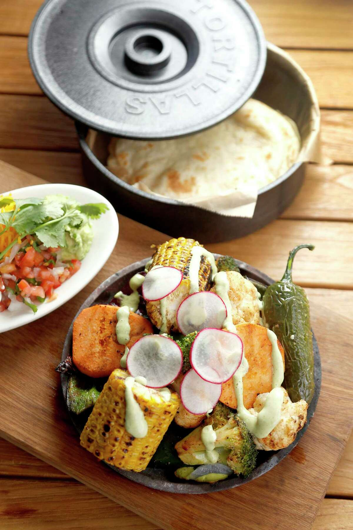 Vegetable Fajitas; cauliflower, cabbage, corn, poblano, root vegetables, and avocado crema avaiable at Superica.