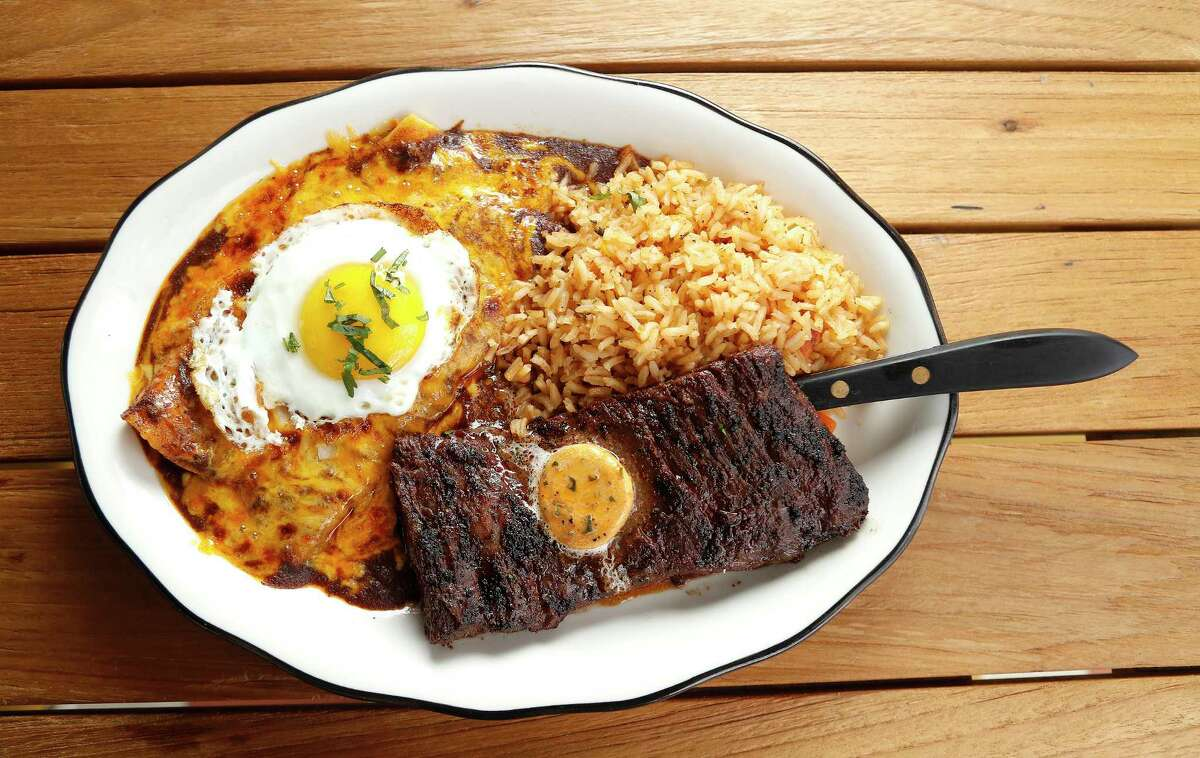 Tampiquena: marinated wood-grilled skirt steak, two cheese enchiladas topped with a fried egg, Mexican rice available at Superica in the Heights.