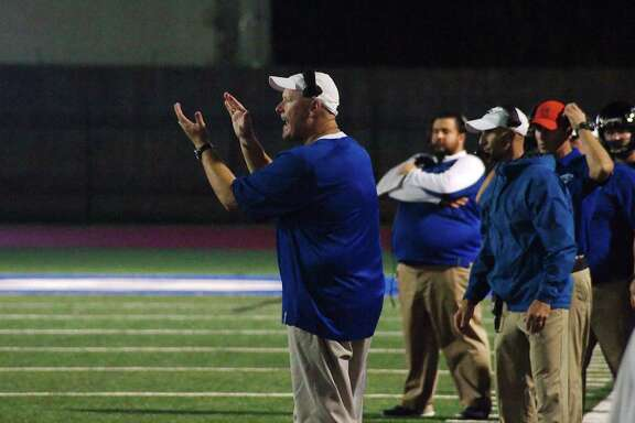 Friendswood football coach Robert Koopmann encourages his troops in Friday's game against Texas City. The Mustangs travel to play Galveston Ball this Friday.