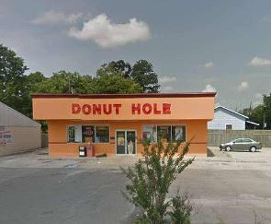Donut Hole1613 16th Street   Score: 83  Violations: Meat improperly stored, sink not draining, personal phones and drinks on prep table, dirty floors, walls and ceiling, no wash hands sign.
