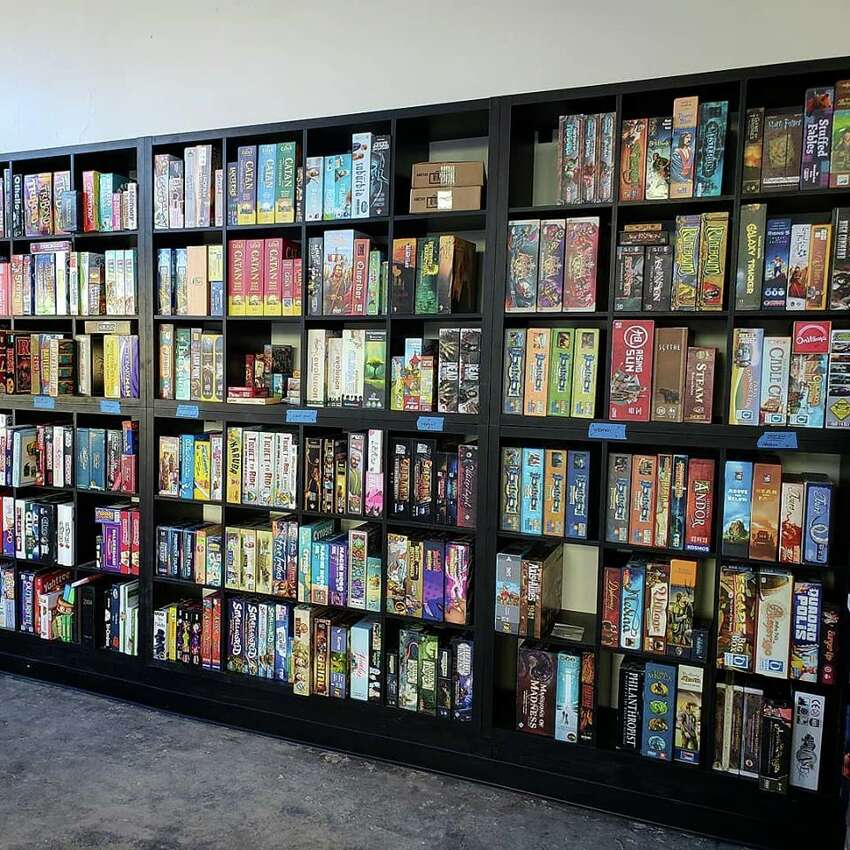 The wall of board games inside the Bard & Baker board-game