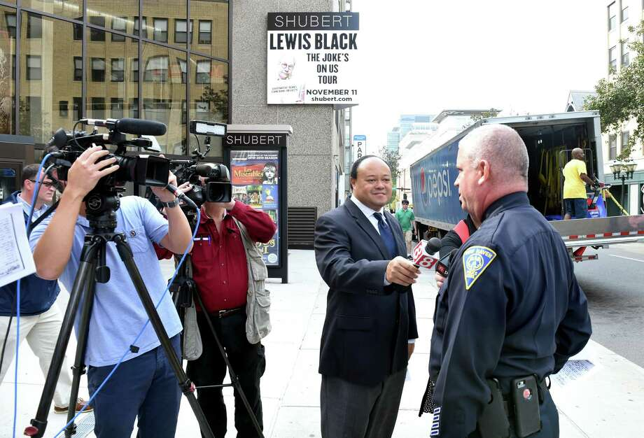 "New Haven Police spokesman David Hartman is interviewed by a crew from ""Inside Edition"" concerning a New Haven police case/incident report from Sept. 26, 1985, about an altercation in which Chris Dudley was arrested at Demery's bar in New Haven. The report cites Brett Kavanaugh as having been questioned in  the incident. In the background is an advertisement for Lewis Black's ""The Joke's on Us Tour"" at the Shubert Theatre. Photo: Arnold Gold / Hearst Connecticut Media / New Haven Register"