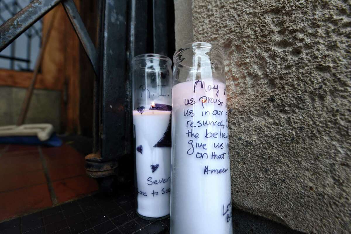 Candles burns in the doorway of Club Phoenix on Central Ave. for Joseph Davis on Tuesday, Oct. 2, 2018, in Albany, N.Y. Davis was fatally shot early Saturday outside the nightclub. (Will Waldron/Times Union)