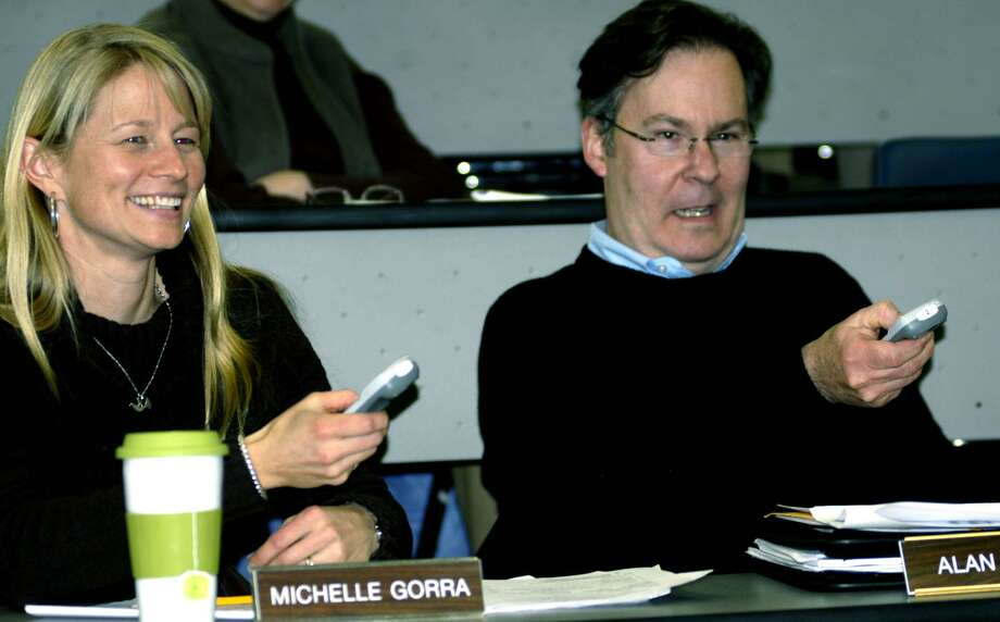 File photo of Region 12 board member Michelle Gorra and Alan Brown testing possible new school district technology during a Jan. 24, 2011 Region 12 Board of Education meeting at Shepaug Valley School in Washington. Photo: Norm Cummings / ST / The News-Times
