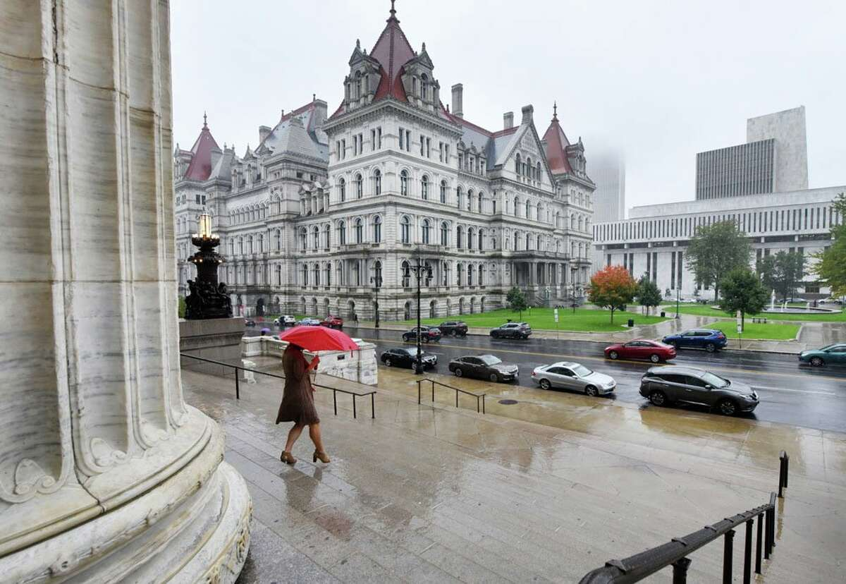 A pedestrian makes her way through the rain in downtown Albany on Tuesday, Oct. 2, 2018. (Will Waldron/Times Union)