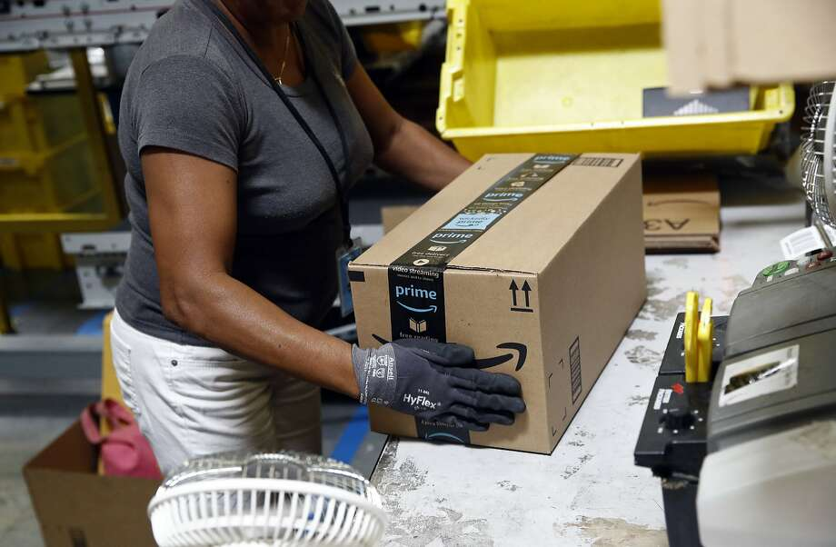 FILE- In this Aug. 3, 2017, file photo, Myrtice Harris applies tape to a package before shipment at an Amazon fulfillment center in Baltimore. Photo: Patrick Semansky, Associated Press