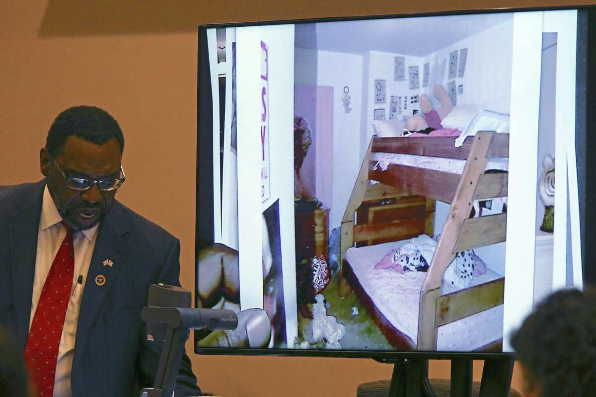 Bexar County Assistant District Attorney Daryl Harris introduces a photograph of Martin Balleza's residence during trial Tuesday.