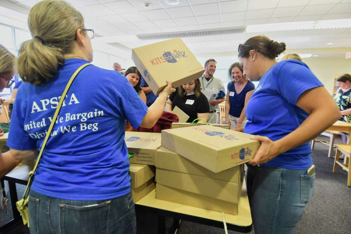 Members of the Albany Public School Teachers Association hand out free book bags and school supplies to new teachers in the Albany School District on Monday, Aug. 27, 2018, in Albany, N.Y. (Paul Buckowski/Times Union archive)