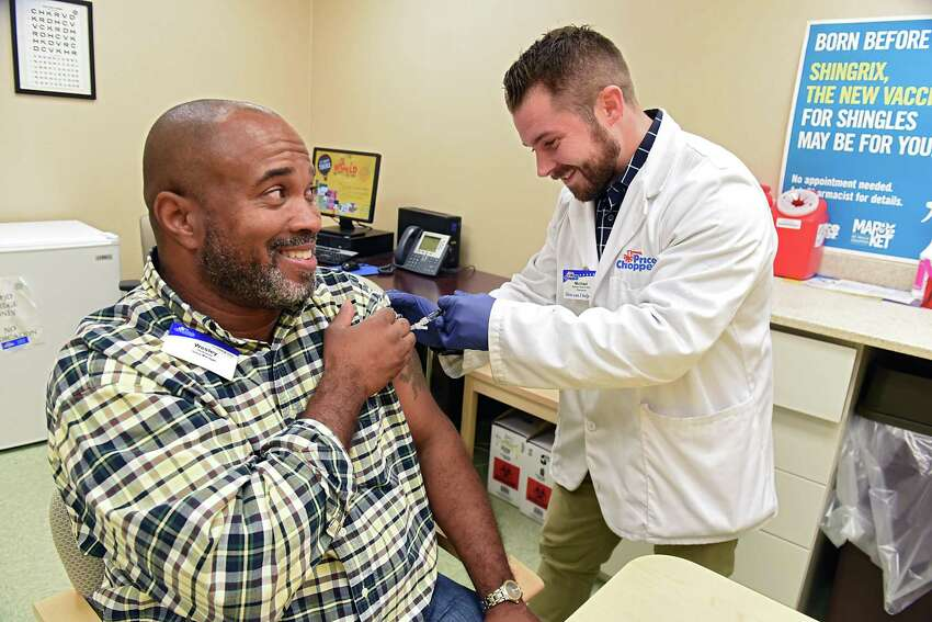 Price Chopper store manager Wesley Holloway gets a flu shot from Price Chopper pharmacist Mike Barkley on Tuesday, Oct. 2, 2018 in Loudonville, N.Y. (Lori Van Buren/Times Union)