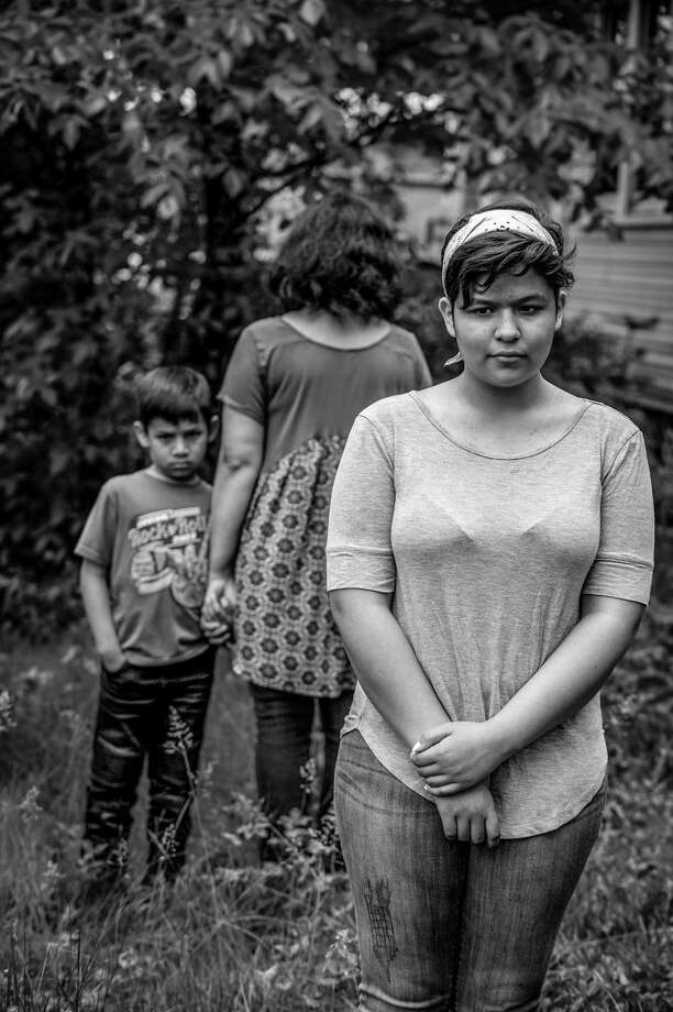 Emily, 14, and her brother Ethan, 7, (no last names are to be used for kids) are concerned that their mother Maria Rivas may be deported to El Salvador when her Temporary Protected Status expires in September. ( Photo: Photo By Mary F. Calvert For The Washington Post) / For The Washington Post