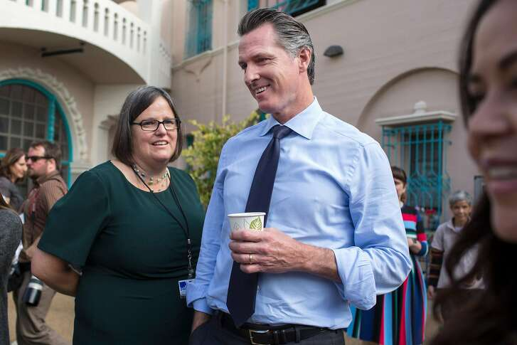Democratic gubernatorial candidate Gavin Newsom with September Jarrett, executive director of San Francisco Office of Early Care & Education, stand together at the preschool playground during a tour at Felton Family Developmental Center. Tuesday, October 2, 2018 in San Francisco Calif.