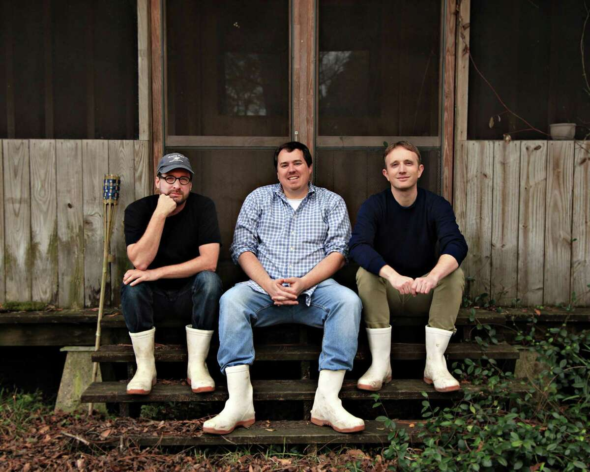 """Co-directors Jeff Springer, Chris Metzler and Quinn Costello, take a break while on location filming """"Rodents of Unusual Size (Tilapia Film)"""" in Louisiana. The 2017 documentary will be shown at Stamford's Avon Theatre on Oct. 3."""