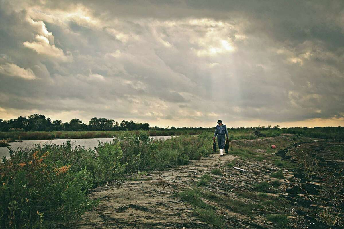 Fisherman and nutria trapper Thomas Gonzales walks the decimated wetlands of southern Louisiana in a scene from the 2017 documentary