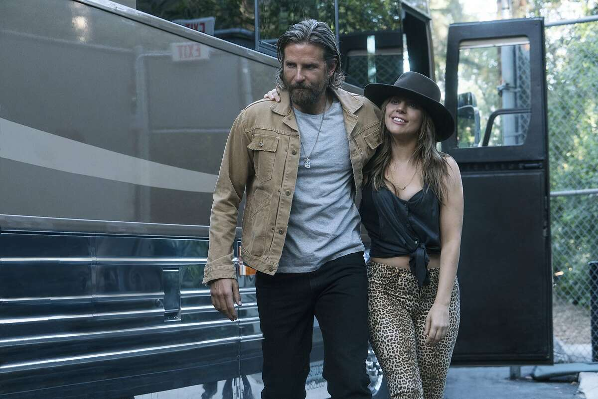 """This image released by Warner Bros. Pictures shows Bradley Cooper, left, and Lady Gaga in a scene from """"A Star is Born."""" (Clay Enos/Warner Bros. Pictures via AP)"""