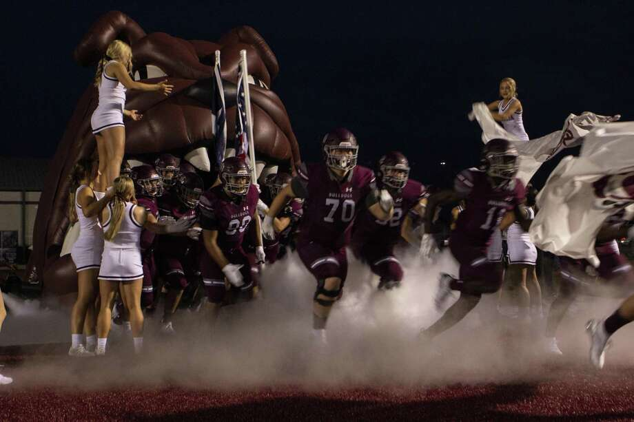 The Magnolia Bulldogs football team runs out onto the field before a District 8-5A (Div. 1) high school football game Friday, Sept. 28, 2018 at Bulldog Stadium in Magnolia. Photo: Cody Bahn, Houston Chronicle / Staff Photographer / © 2018 Houston Chronicle