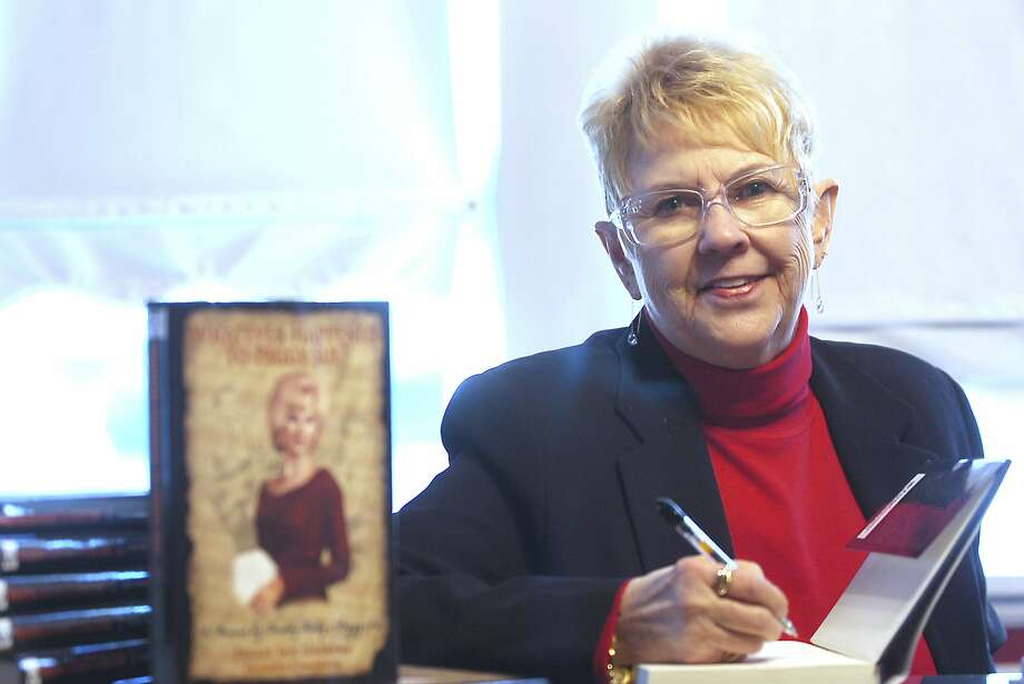 "FILE - In this Jan. 11, 2008, file photo, Peggy Sue Gerron unveils her new book ""What Ever Happened to Peggy Sue"" during a press conference in Tyler, Texas. Gerron, the Texas woman who inspired the 1958 Buddy Holly song ""Peggy Sue"" has died at a Lubbock hospital. Gerron Rackham of Lubbock died Monday, Oct. 1, 2018, at University Medical Center. She was 78. (Jaime R. Carrero/Tyler Morning Telegraph, via AP, File) Photo: Jaime R. Carrero, Associated Press"