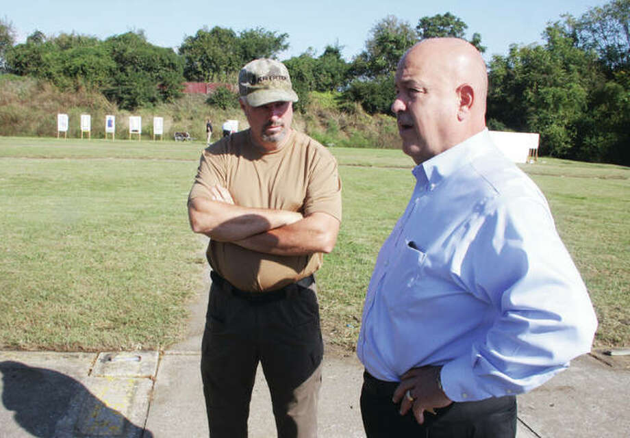 John Redstone, left, range officer at the Granite City Police Department firing range, talks to Madison County Sheriff's Department Director of Support Services Robert Rizzi, while Sheriffs Department officials toured the range. The department is working on major improvements at its own firing range, located on part of an old Nike missile base on Fruit Road. Photo: Scott Cousins | The Telegraph