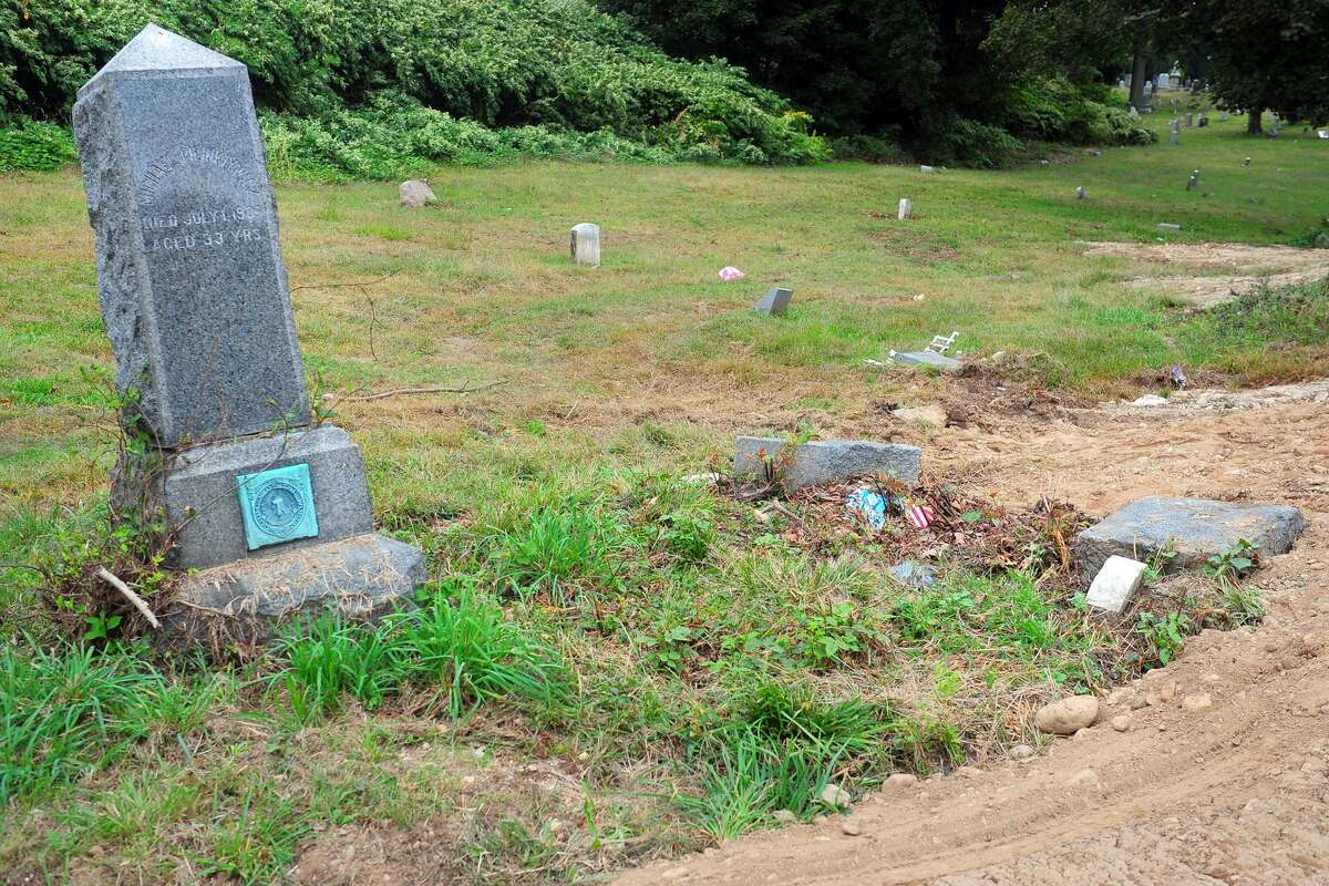 Headstones that had been toppled and moved in Park Cemetery, in Bridgeport, Conn. Oct. 2, 2018. Human bones, casket pieces found scattered in cemetery Park Cemetery in Bridgeport is the final resting place of Civil and Spanish-American war veterans and former Bridgeport Mayor Jasper McLevy. In 2018, police detectives made a macabre discovery here. The hallowed grounds were littered with human bone fragments and pieces of casket, police said. During a court hearing, detectives told Superior Court Judge Elizabeth Stewart that dozens of headstones, some dating back to the 1800s, had been moved so that the newly dead could be buried in plots stacked on old graves. Read more.