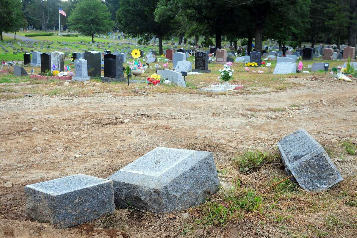 Headstones that have been toppled and moved in Park Cemetery, in Bridgeport, Conn. Oct. 2, 2018. It is believed that some older graves and grave markers in the cemetery have been moved in effort to make way for newer burials.